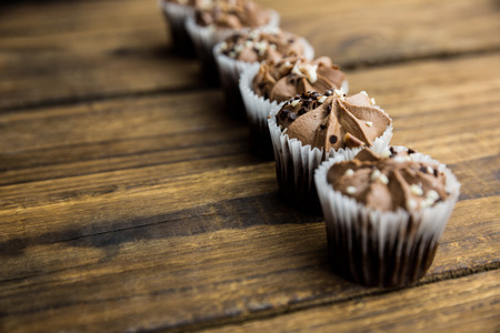 calorific: Chocolate cupcakes on a table shot in studio Stock Photo
