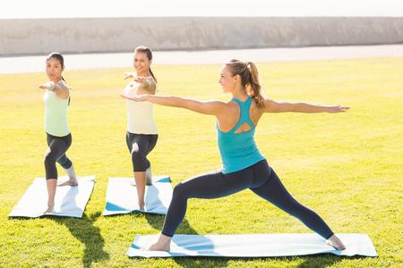 attending: Sporty women attending yoga class in parkland