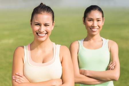 parkland: Portrait of smiling sporty women with arms crossed in parkland
