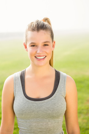 parkland: Portrait of smiling sporty blonde looking at camera in parkland