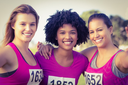 breast: Runners supporting breast cancer marathon and taking selfies in parkland
