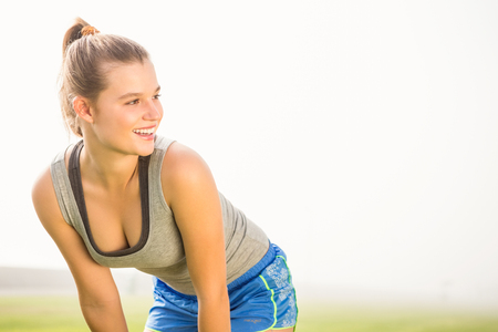 parkland: Smiling sporty blonde resting in parkland Stock Photo
