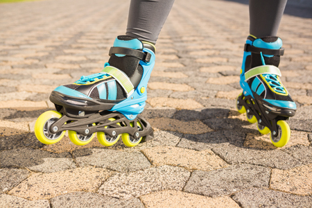 inline: Close up view of woman wearing inline skates at promenade Stock Photo