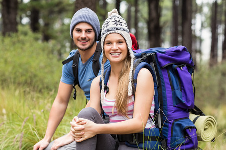 rucksack ': Portrait of a young smiling hiker couple in the nature