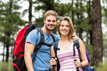 walking pole: Portrait of a smiling hiker couple  in the nature Stock Photo