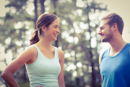 adventuring: Happy joggers looking at each other in the nature