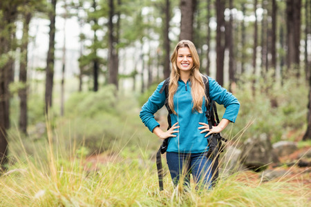 adventuring: Portrait of a young pretty hiker in the nature Stock Photo