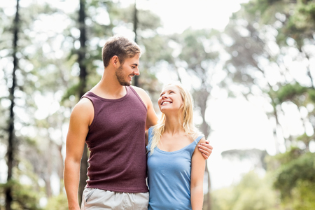 adventuring: Young happy joggers looking at each other in the nature Stock Photo