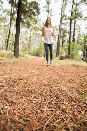 adventuring: Young happy jogger walking in the nature Stock Photo