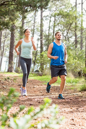 joggers: Happy joggers running in the nature