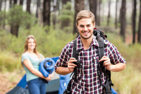 adventuring: Portrait of a young handsome hiker in the nature Stock Photo