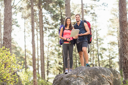 joggers: Young happy joggers looking at camera in the nature Stock Photo
