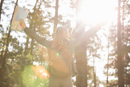 carefree: Carefree blonde hiker with arms outstretched in the nature