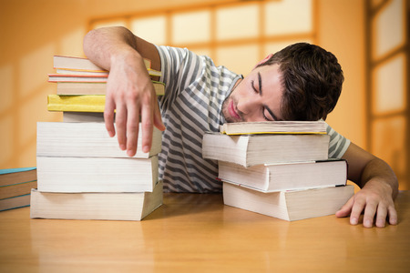 slump: Student asleep in the library against room with large window showing city