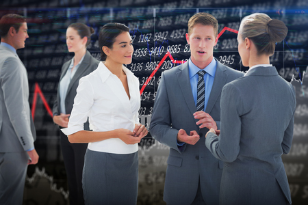 people interacting: Business people interacting  against stocks and shares Stock Photo