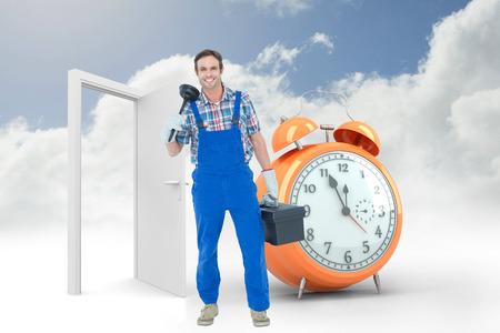 tool box: Portrait of plumber holding plunger and tool box against alarm clock counting down to twelve