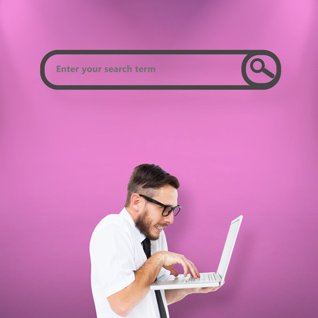 geeky: Geeky businessman using his laptop against pink Stock Photo