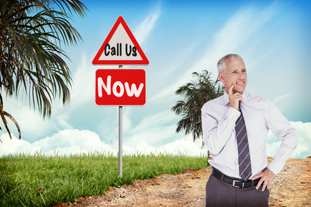 hazard: Businessman thinking against hazard signs beside trail