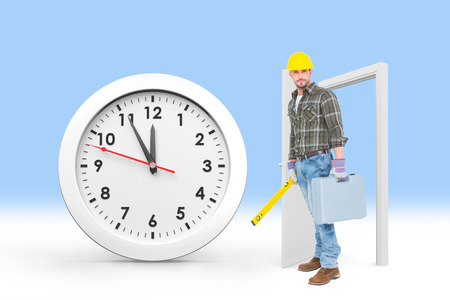 spirit level: Manual worker with spirit level and toolbox against countdown to midnight on clock