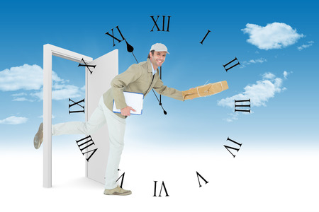 against the clock: Happy delivery man running while holding parcel against clock counting down to midnight Stock Photo