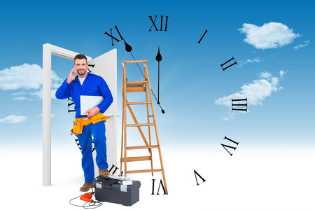 against the clock: Carpenter on the phone  against clock counting down to midnight Stock Photo
