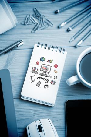 breaking news: breaking news doodle against notepad on desk