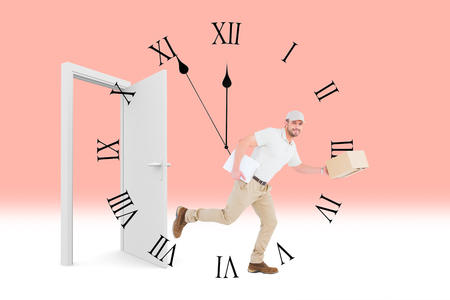 against the clock: Delivery man with cardboard boxes running  against clock counting down to midnight