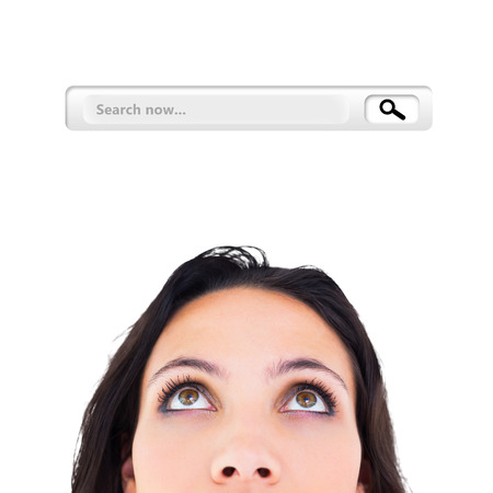 Pretty brunette looking up thoughfully against search engine Stock Photo