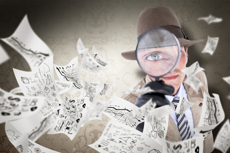 patterned wallpaper: Spy looking through magnifier against elegant patterned wallpaper in neutral tones Stock Photo