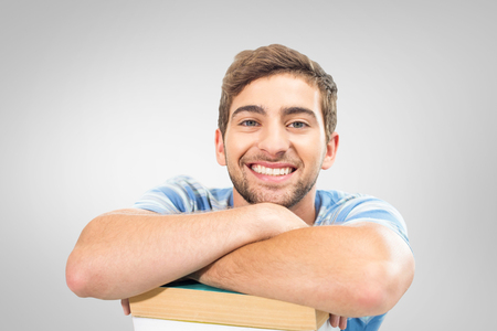 revision: Students studying against grey vignette Stock Photo