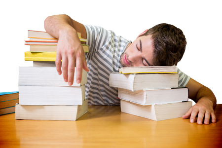 slump: Student asleep in the library against white background with vignette