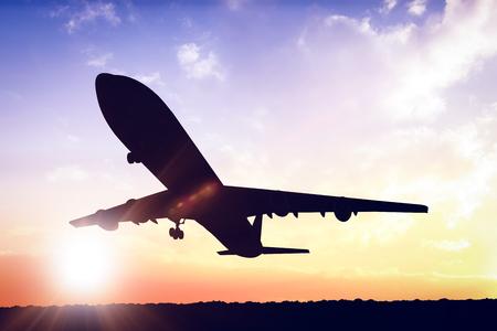 against the sun: Graphic airplane against sun shining