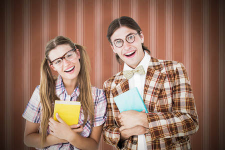 together with long tie: Geeky hipsters smiling at camera  against background Stock Photo