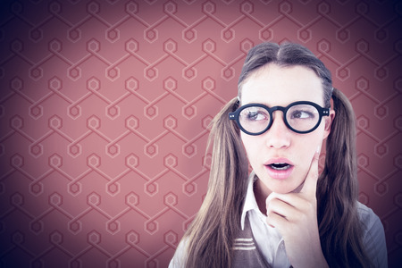 geeky: Female geeky hipster looking confused  against background Stock Photo