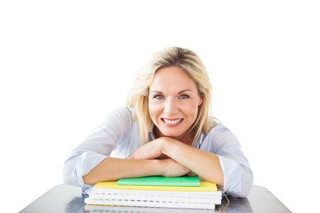 mature student: Mature student smiling against white background with vignette Stock Photo