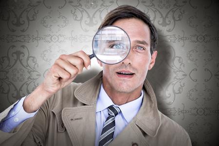 patterned wallpaper: Spy looking through magnifier against elegant patterned wallpaper in grey tones