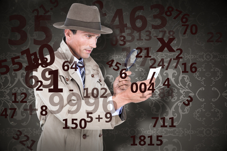 patterned wallpaper: Spy looking through magnifier against elegant patterned wallpaper in grey Stock Photo