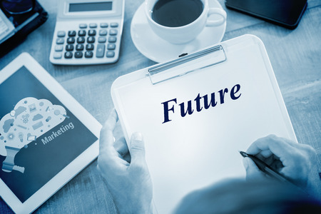 smartphone in hand: The word future and man writing on clipboard on working desk against digital marketing graphic Stock Photo