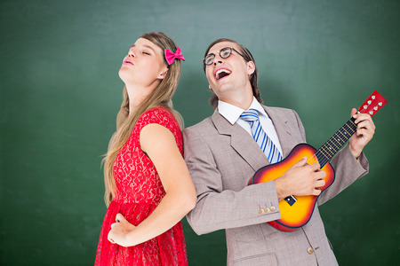 together with long tie: Hipster couple having fun together against green chalkboard Stock Photo