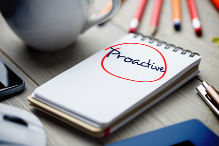 proactive: The word proactive against notepad on desk