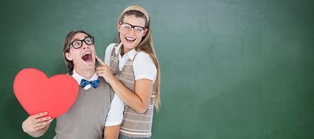 together with long tie: Excited geeky hipster and his girlfriend  against green chalkboard
