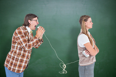 together with long tie: Geeky hipsters using string phone  against green chalkboard
