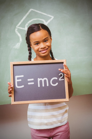 the theory of relativity: Theory of relativity against portrait of cute little girl holding school slate
