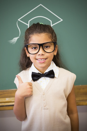 to make believe: Graduation hat vector against cute pupil dressed up as teacher in classroom Stock Photo