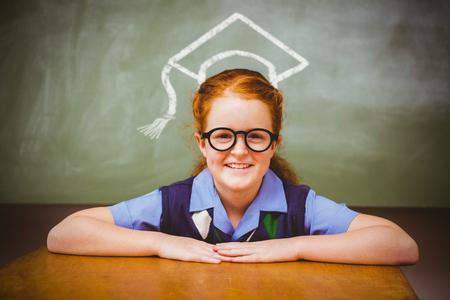 cute little girl smiling: Graduation hat vector against cute little girl smiling in classroom Stock Photo