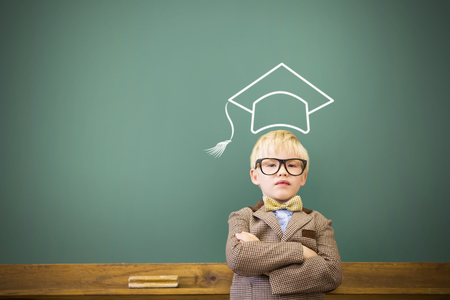 Graduation hat vector against cute pupil dressed up as teacher in classroom Stock Photo