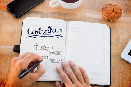controlling: The word controlling and man writing notes on diary against business concept vector