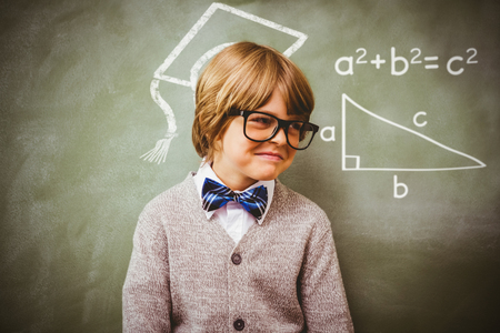 boy smiling: Trigonometry against boy smiling in front of blackboard Stock Photo