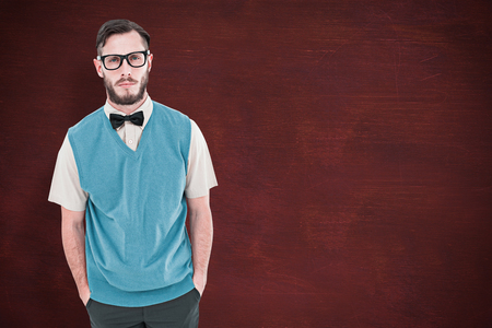geeky: Geeky hipster looking at camera against desk