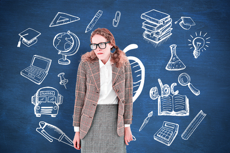 restless: Geeky hipster woman looking nervous against blue chalkboard